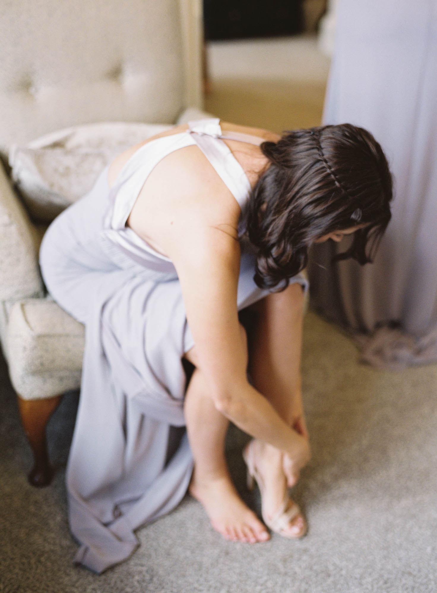 Bridesmaid putting on her shies captured by Oxford Wedding Photographer Camilla Arnhold