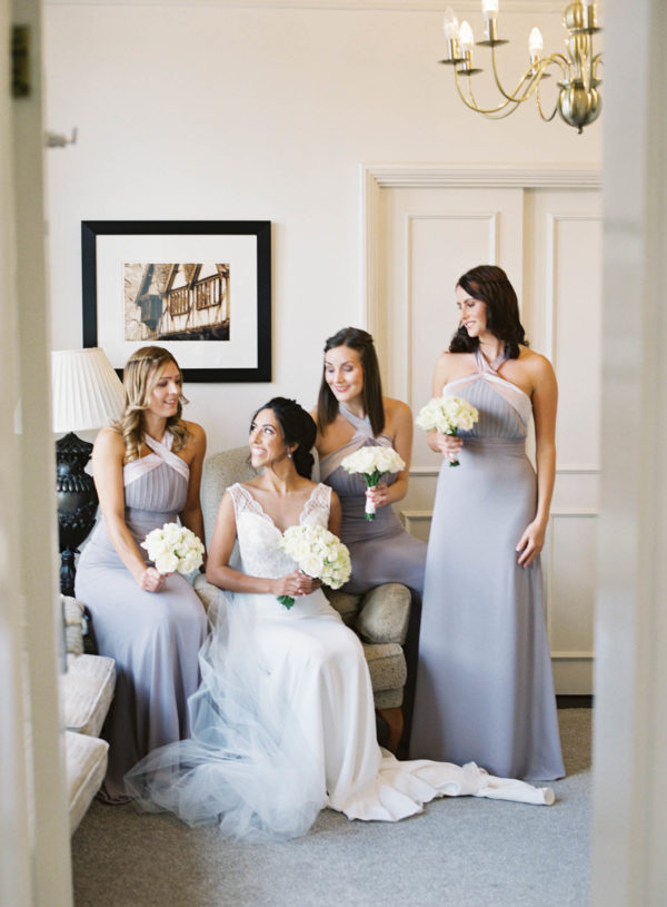 Bride laughing and chatting with bridesmaids
