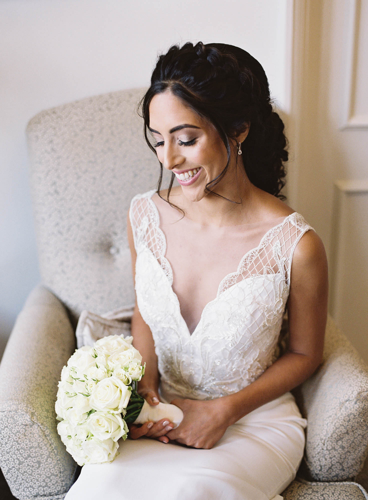 Sophisticated and elegant bride sitting in chair at The Randolph Hotel Oxford captured by Oxford Wedding Photographer Camilla Arnhold
