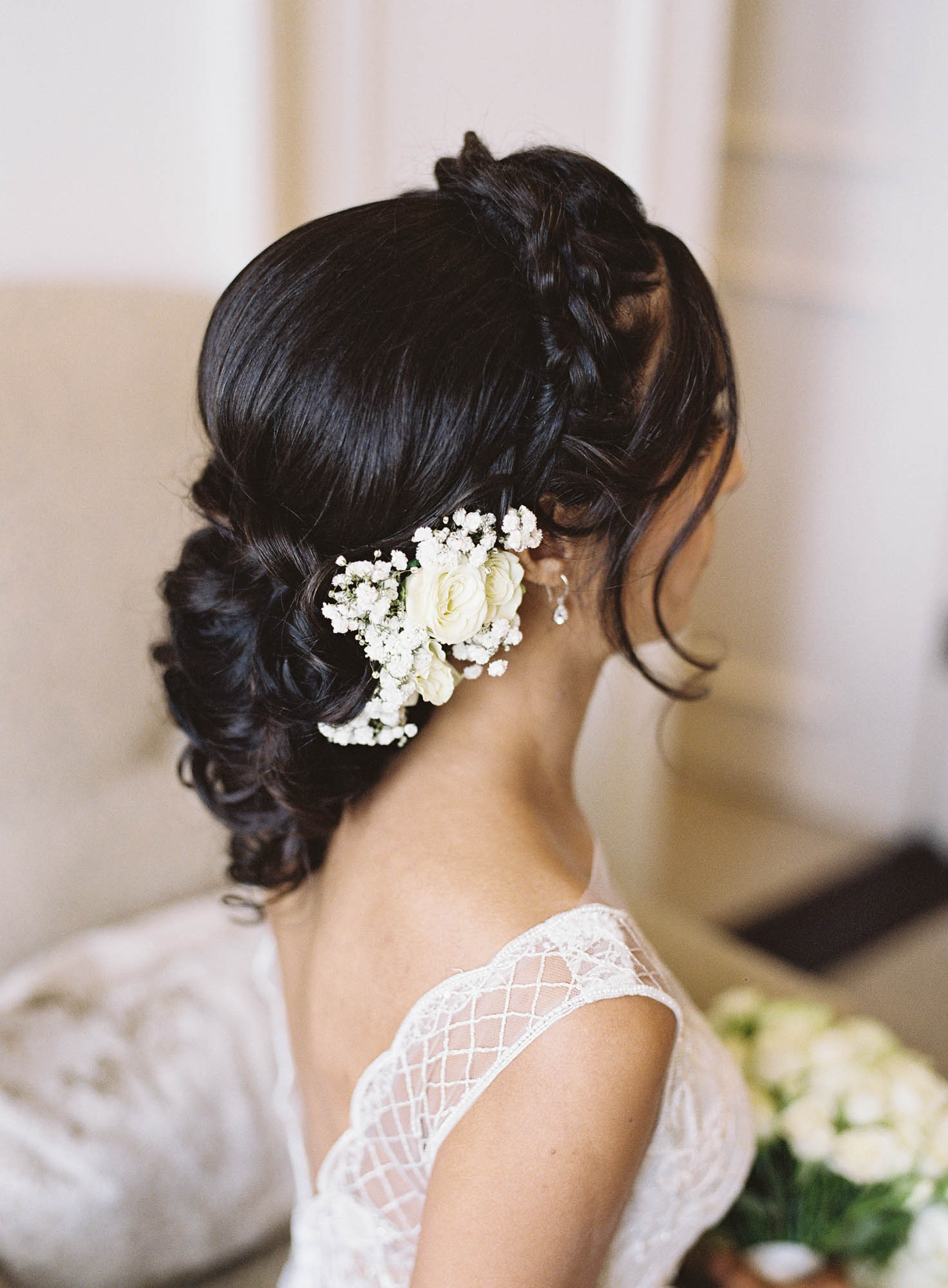 Elegant bridal up do wedding hair with plaits and flowers