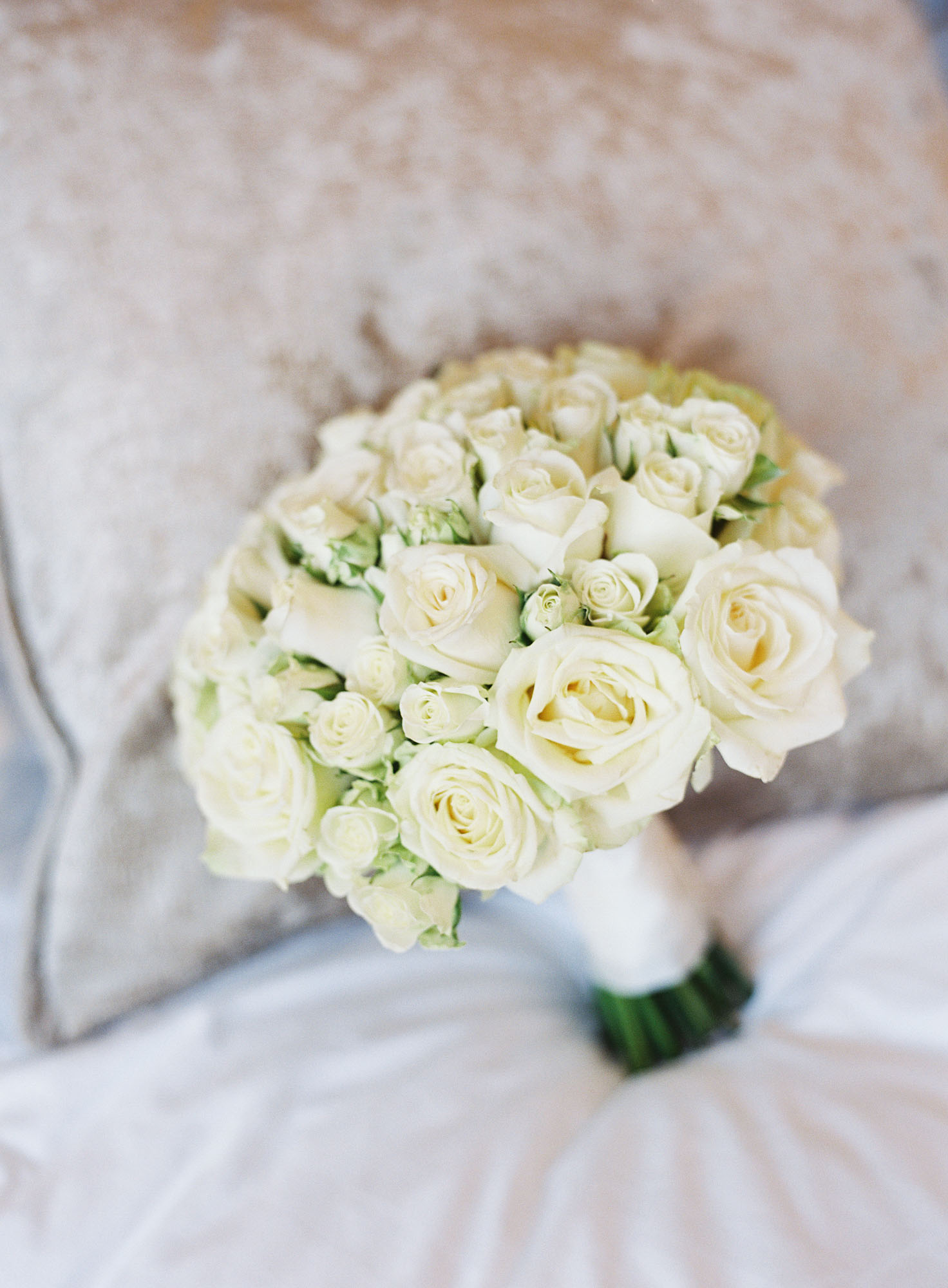 Wedding bouquet of white roses at Oxford Wedding