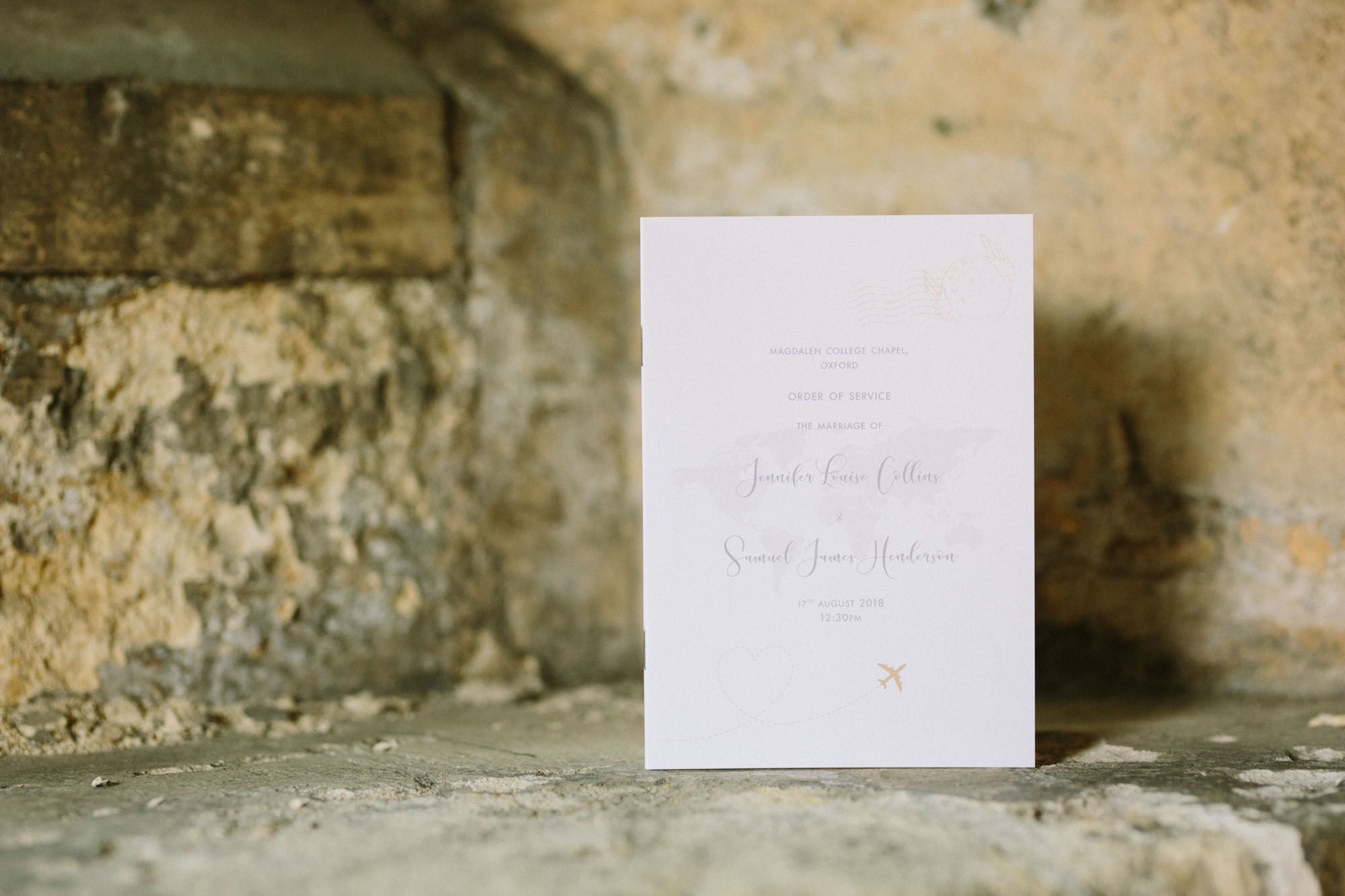 Wedding order of service with elegant calligraphy on stone ledge in Magdalen College Oxford