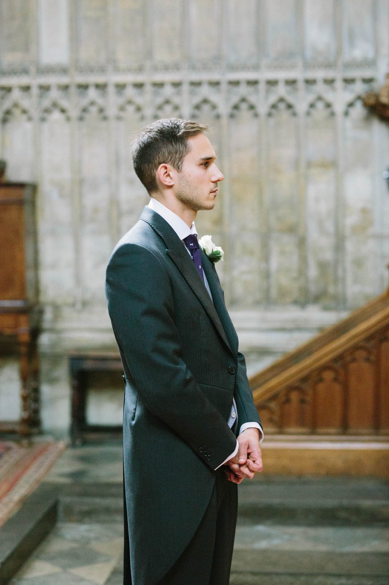 Groom awaiting the arrival of bride in Magdalen College Chapel