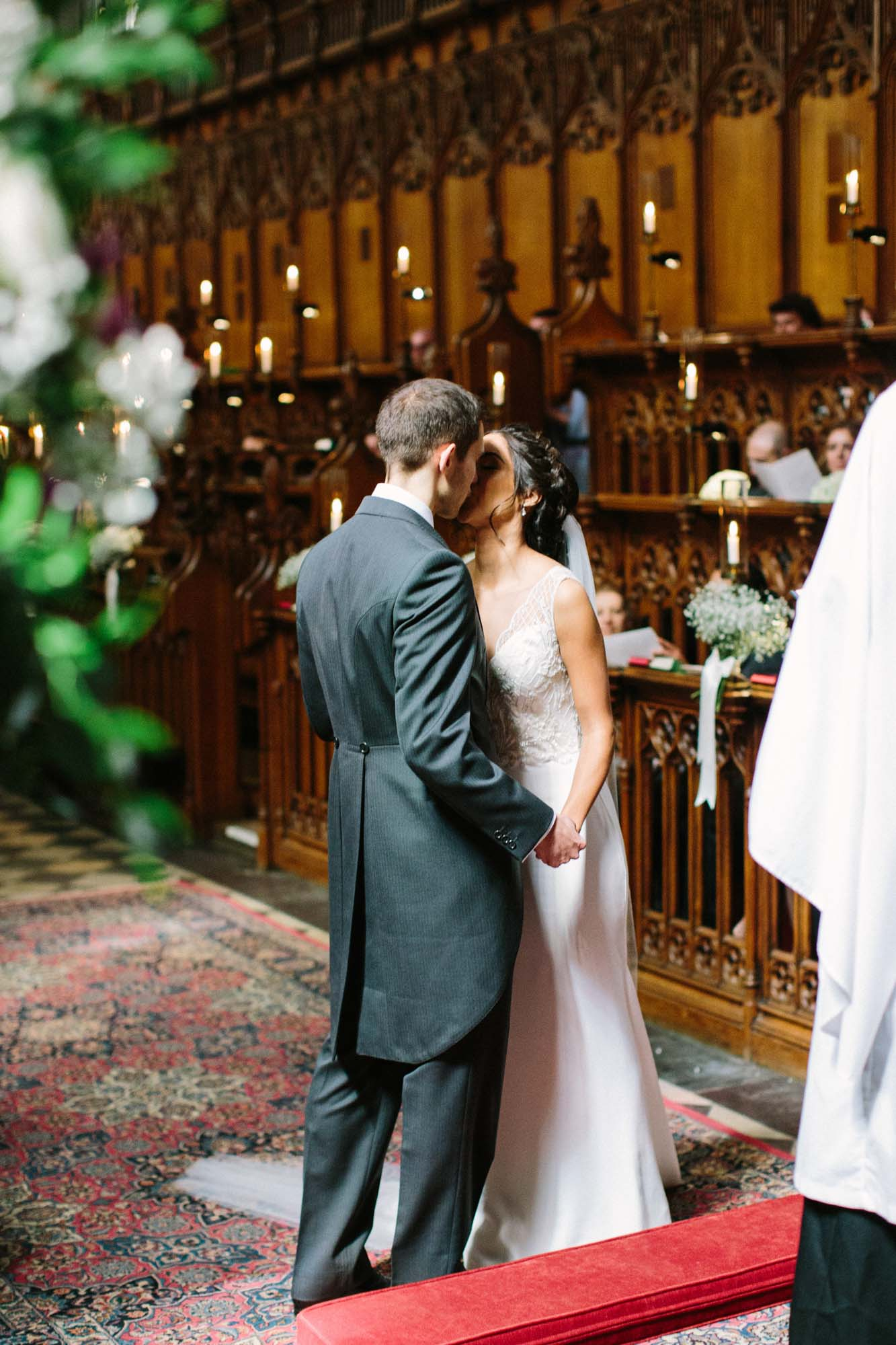 Bride and Groom's first kiss in Magdalen College Oxford Chapel