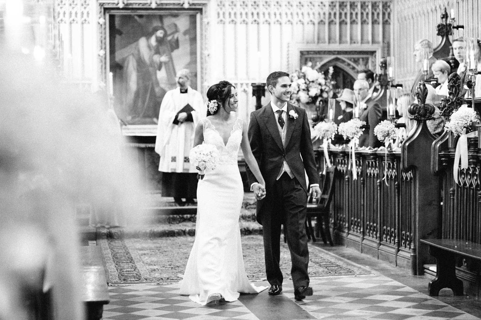 Bride and groom exiting the chapel at Magdalen College Oxford
