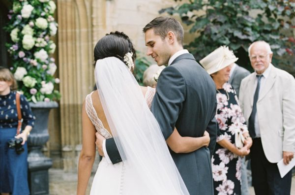 Bride and groom with arms around eachother captured by Oxford Wedding Photographer