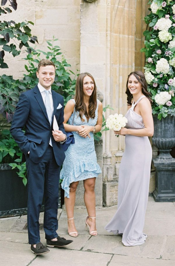 Wedding guests smiling for a photograph by Oxford Wedding Photographer Camilla Arnhold