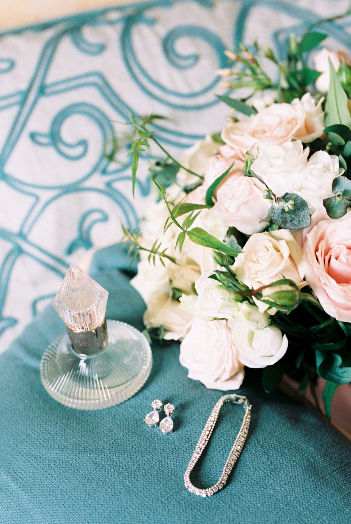 Classic and elegant bridal style. Rose bouquet, wedding perfume and diamond jewellery