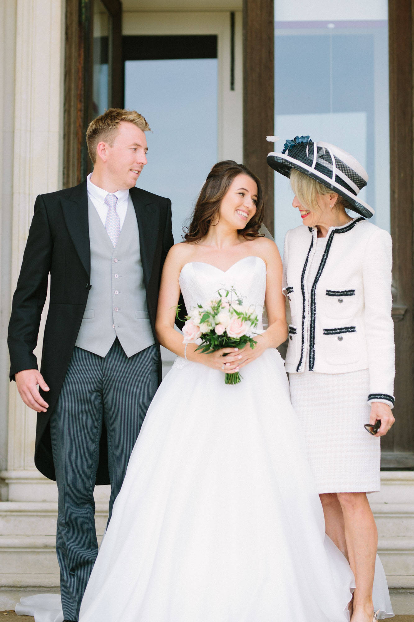 Bride with mother and brother in the entrance to Stansted House