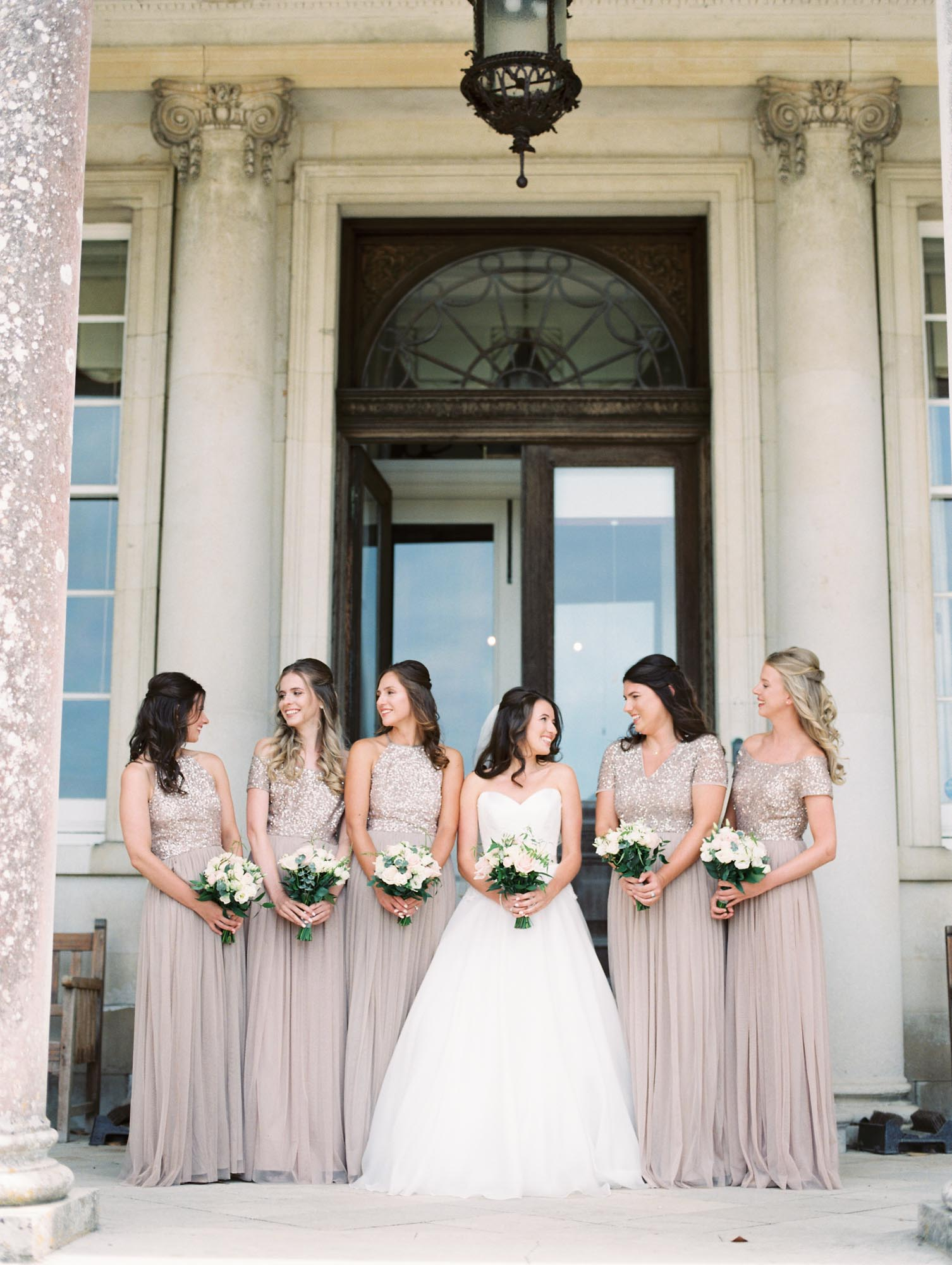 Film wedding photography. Bride with bridesmaids outside Stansted House