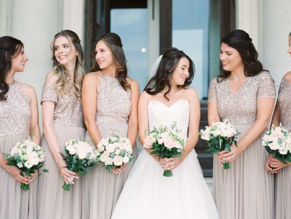Bride and bridesmaids in blush sequins holding bouquets