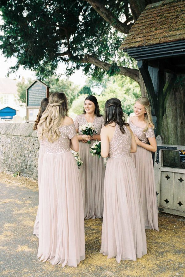 Bridesmaids waiting for the arrival of the bride at the church in Westbourne on wedding day