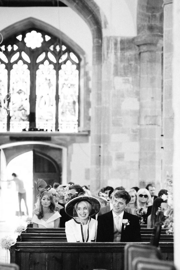 Mother of the bride waiting for the brides entrance to Westbourne Church