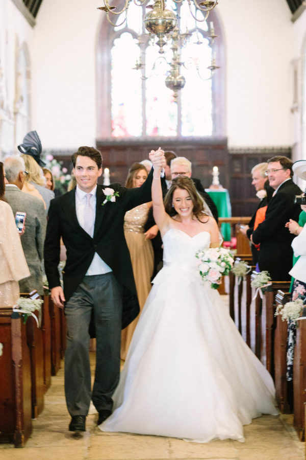 Bride and groom exiting the church on wedding day