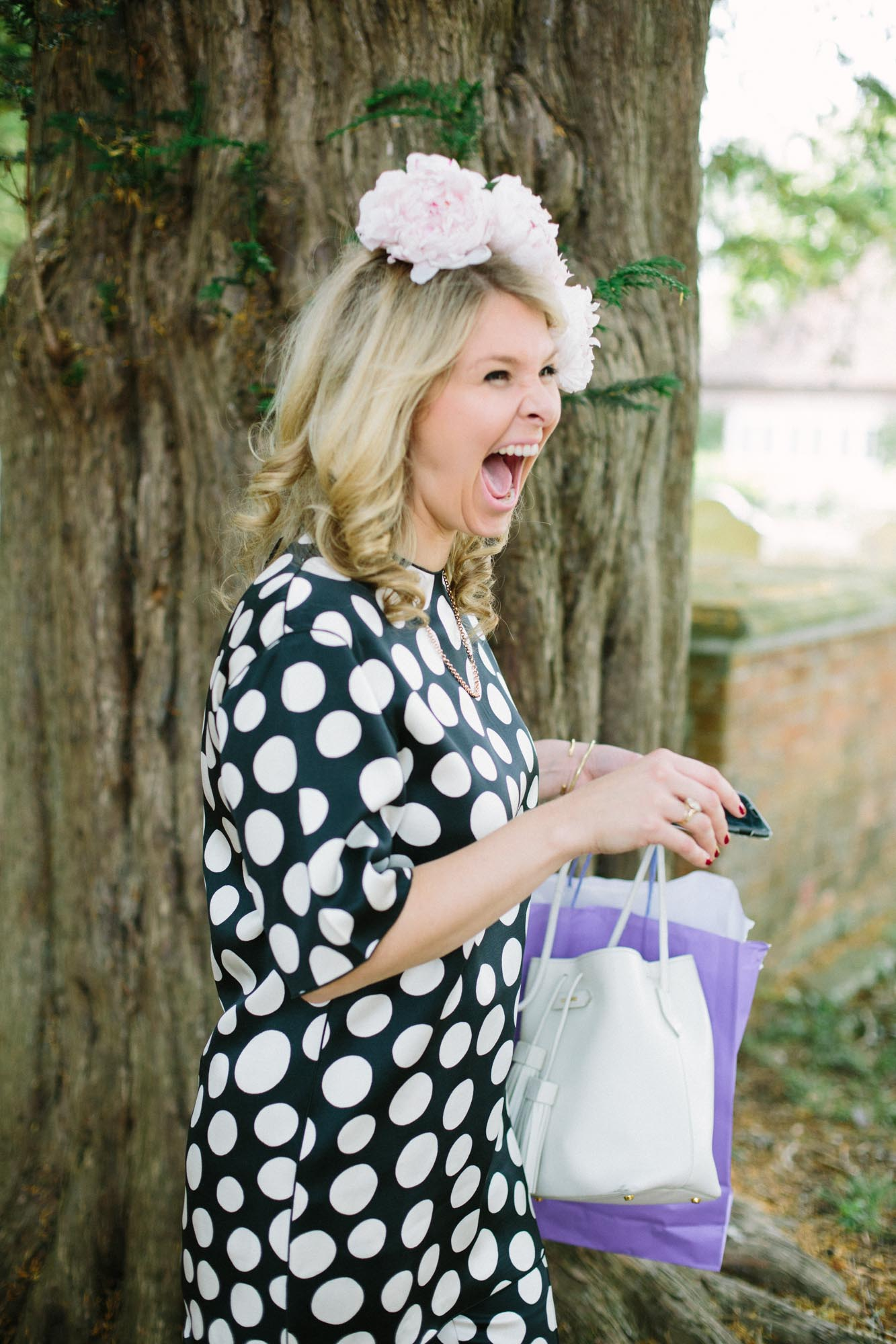 Wedding guest laughing outside church