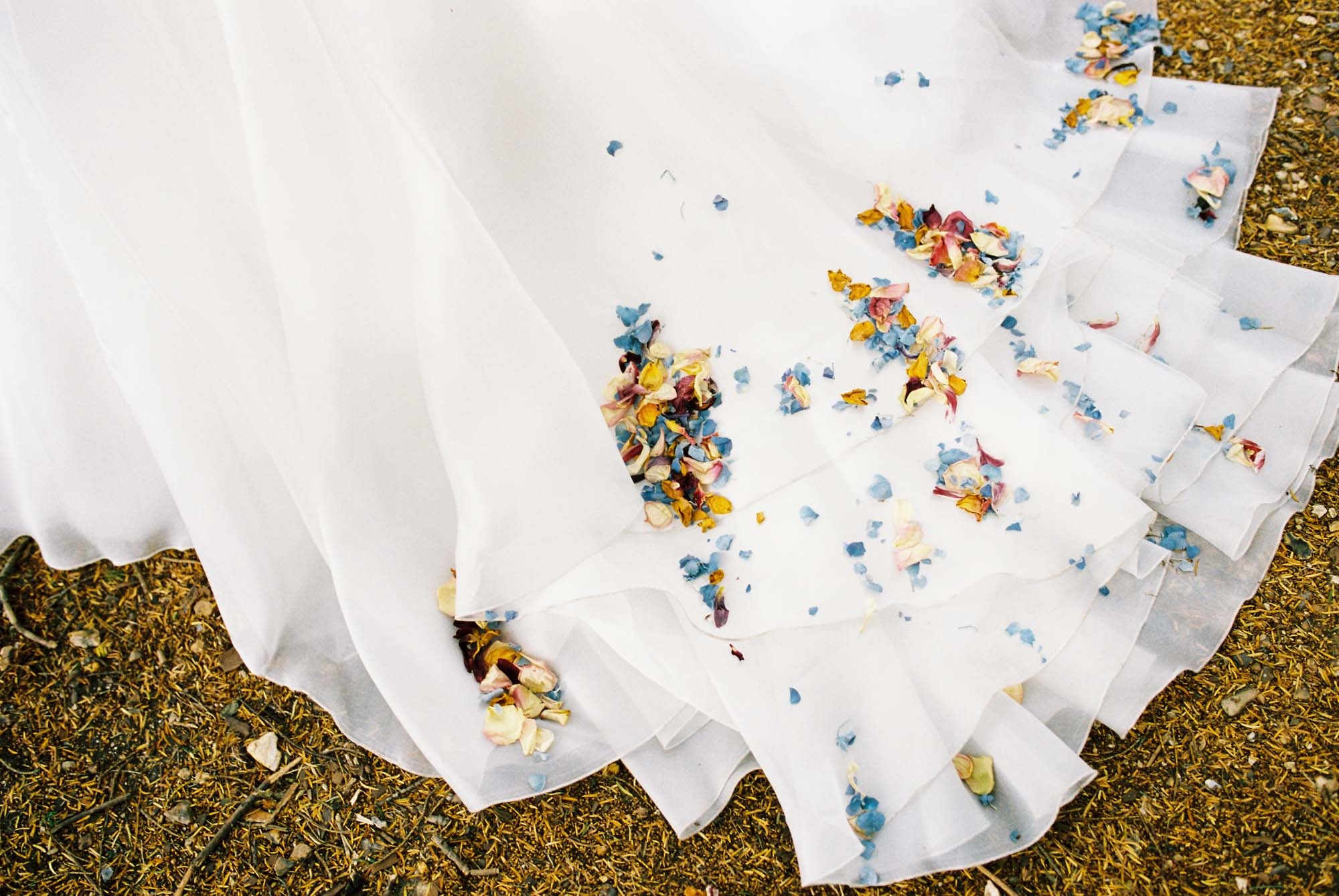 Confetti on wedding dress