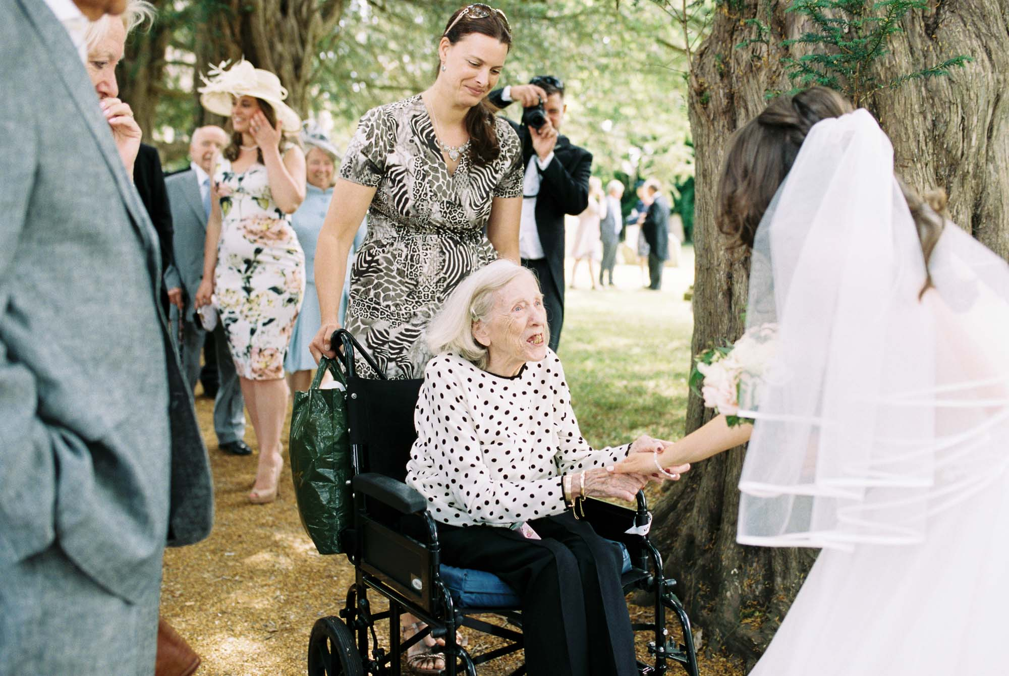 Bride greeting grandmother at wedding