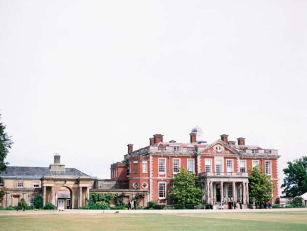 Stansted House on wedding day with guests outside