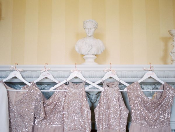 Blush sequin bridesmaids dresses hanging up in the Stansted House bridal suite