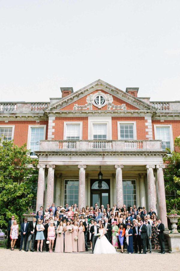 Group photo of entire wedding party at Stansted House