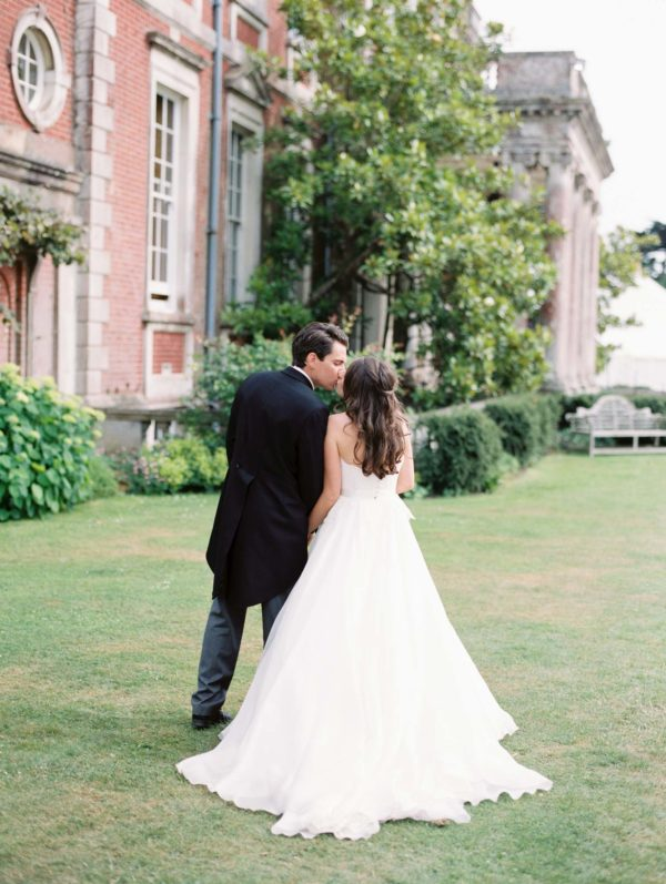 Bride and groom kissing at their wedding at Stansted House