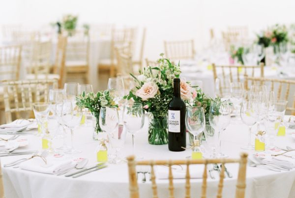 Wedding tables with Limoncello and roses at Stansted House wedding