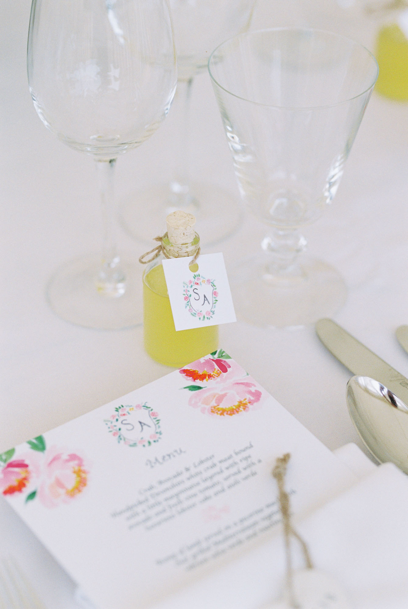 Limoncello wedding favours and menu on table at Stansted House