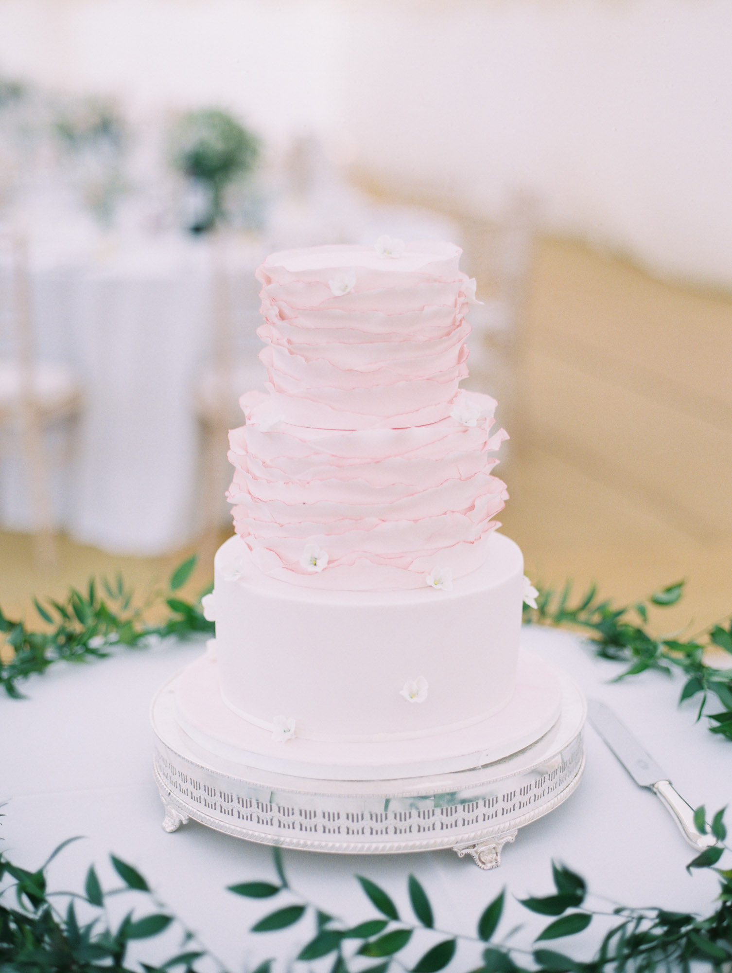 Pink ombre ruffled three tier wedding cake