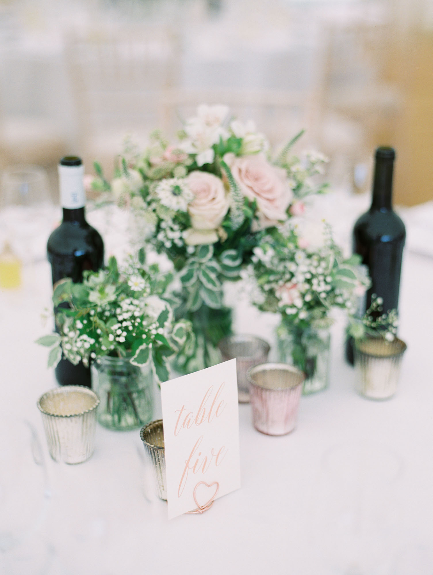 Calligraphy table names and metallic tea light wedding decor