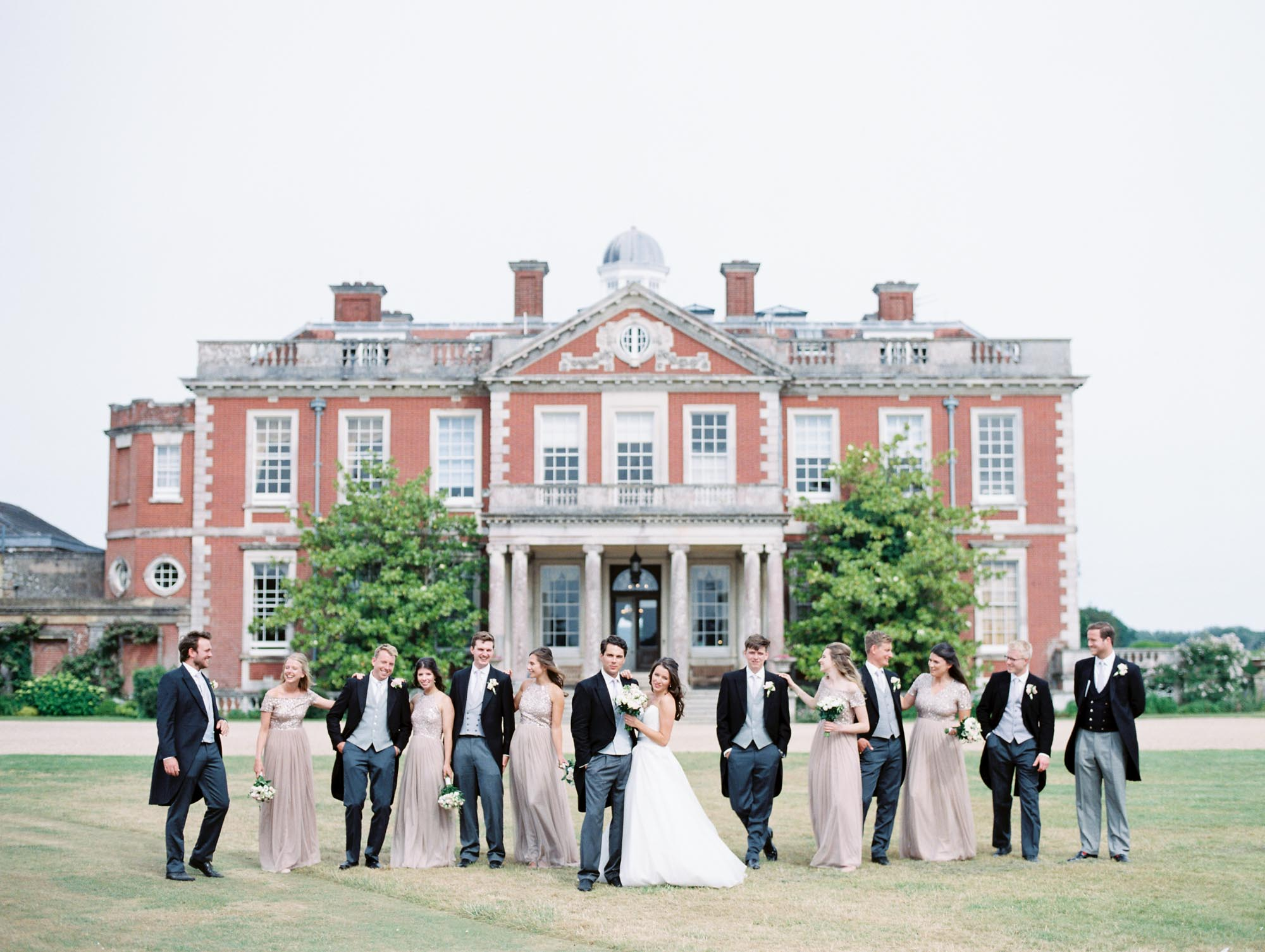 Bridal party standing outside Stansted House