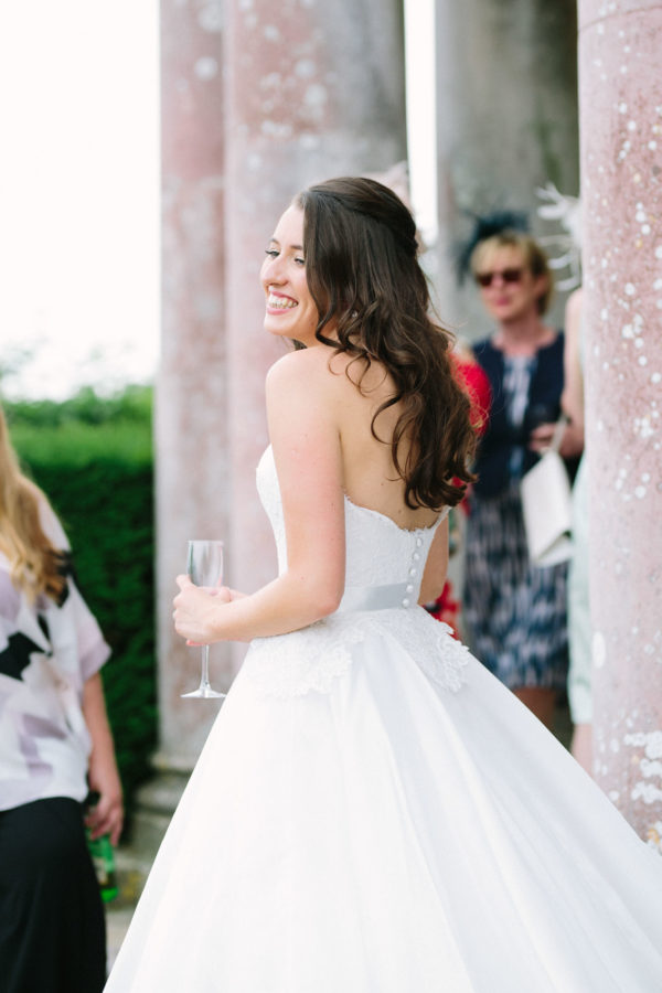 bride smiling during wedding reception at Stansted House wedding