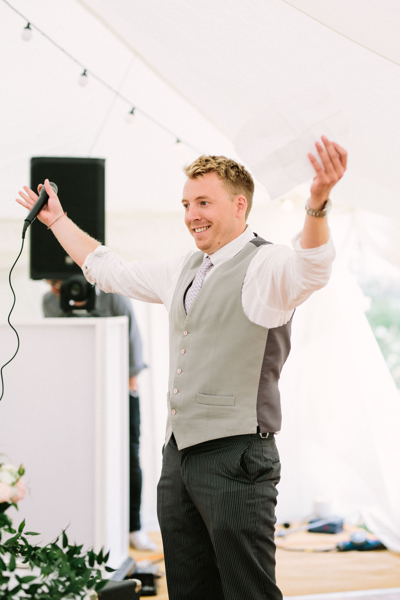 Brother of bride giving speech on wedding day