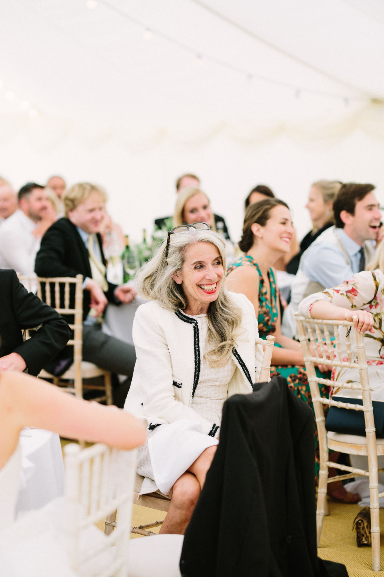 Mother of the bride laughing during wedding speeches at Stansted House wedding
