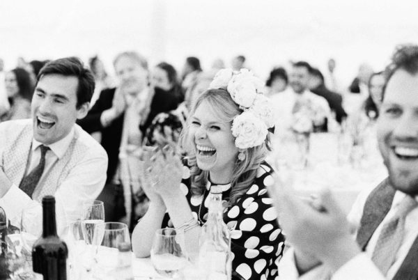 Wedding guests laughing and clapping during speech at Stansted House wedding