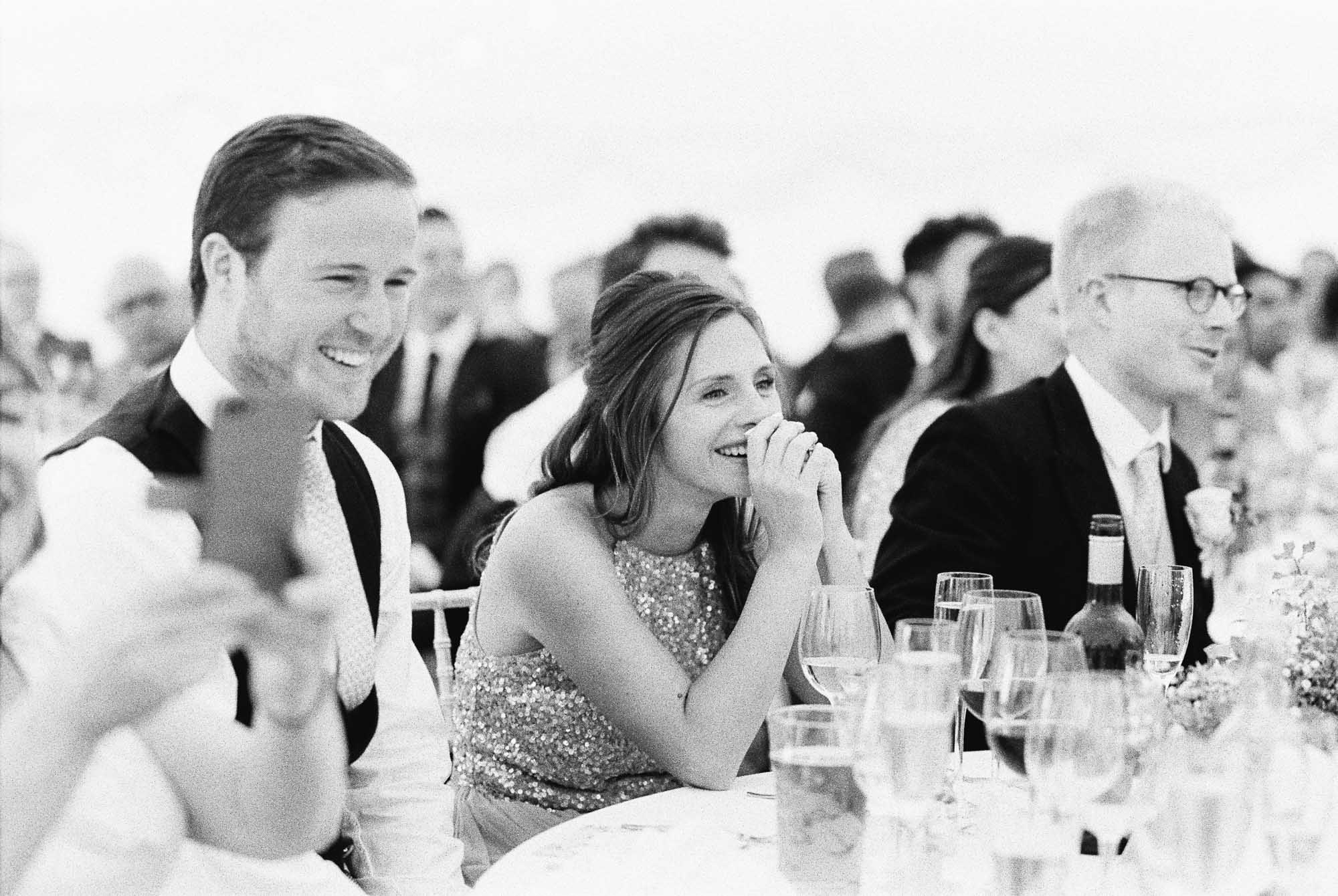 Wedding guests laughing during speeches at Stansted House