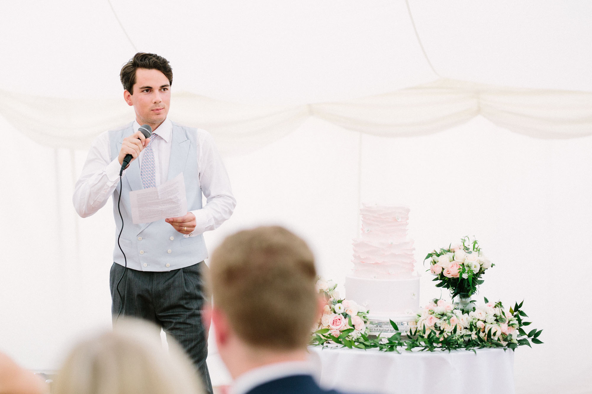 Groom giving speech during wedding breakfast