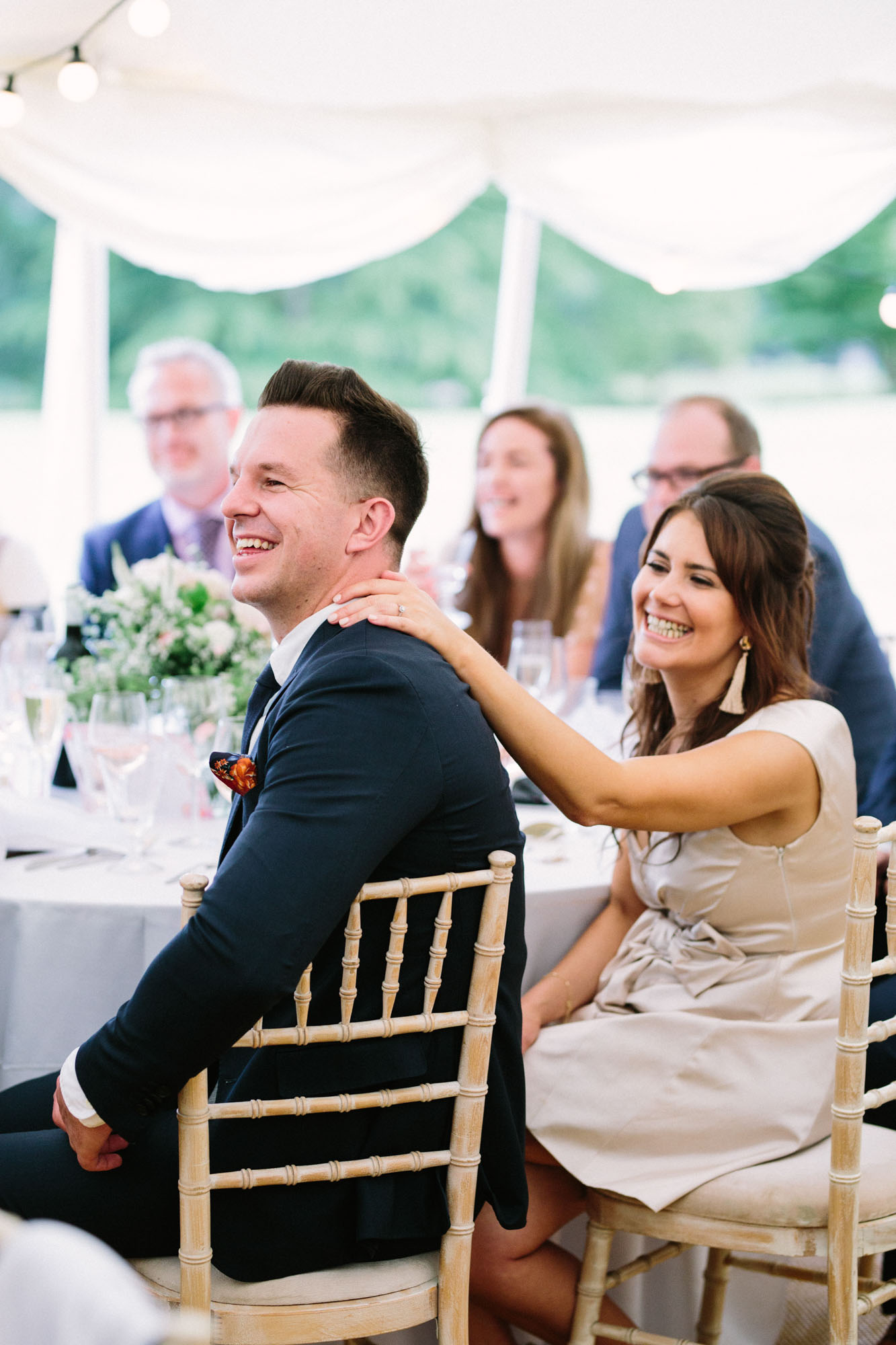 Wedding guests enjoying speeches on wedding day at Stansted House