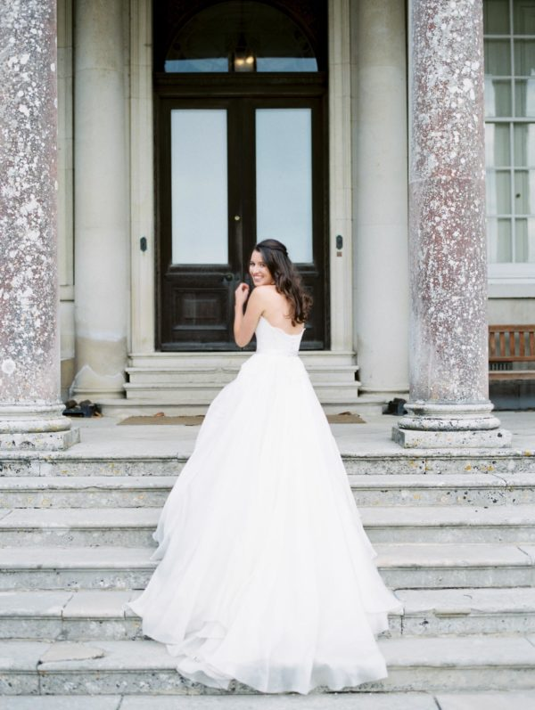 Beautiful elegant bride on the steps of Stansted House