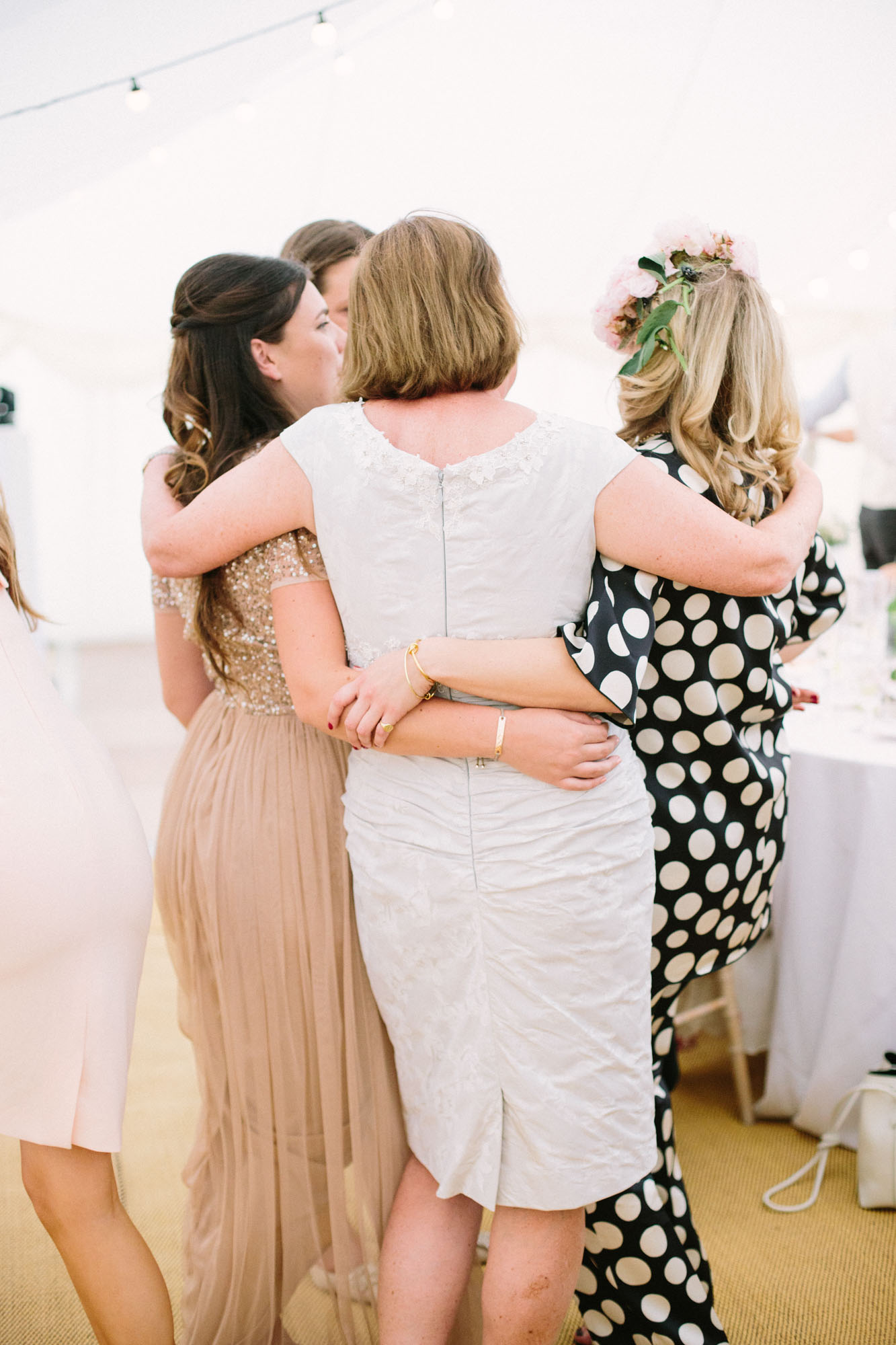 Mother of the groom hugging wedding guests in the evening party of a Stansted House wedding