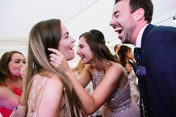 wedding guests dancing and laughing at Stansted House wedding