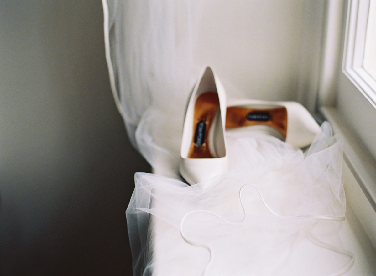 Tom Ford wedding shoes with veil on windowsill at Thorpe Manor Oxford