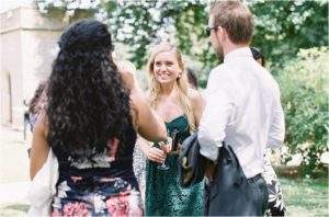Natural photograph of wedding guests at Chiddingstone Castle wedding