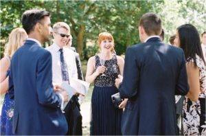 Wedding guests laughing at Chiddingstone Castle