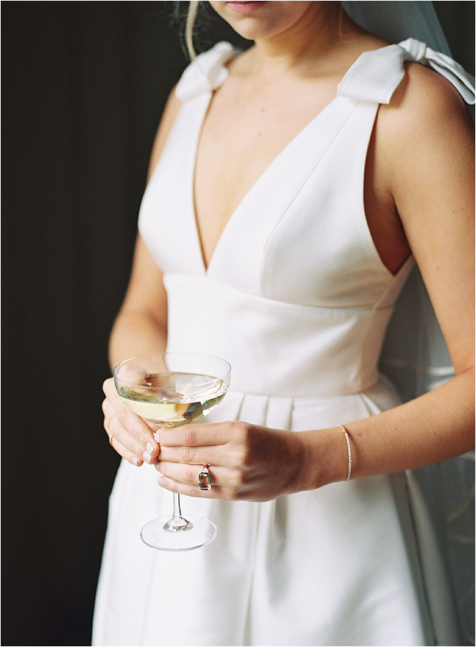 Elegant and sophisticated bride holding glass of champagne