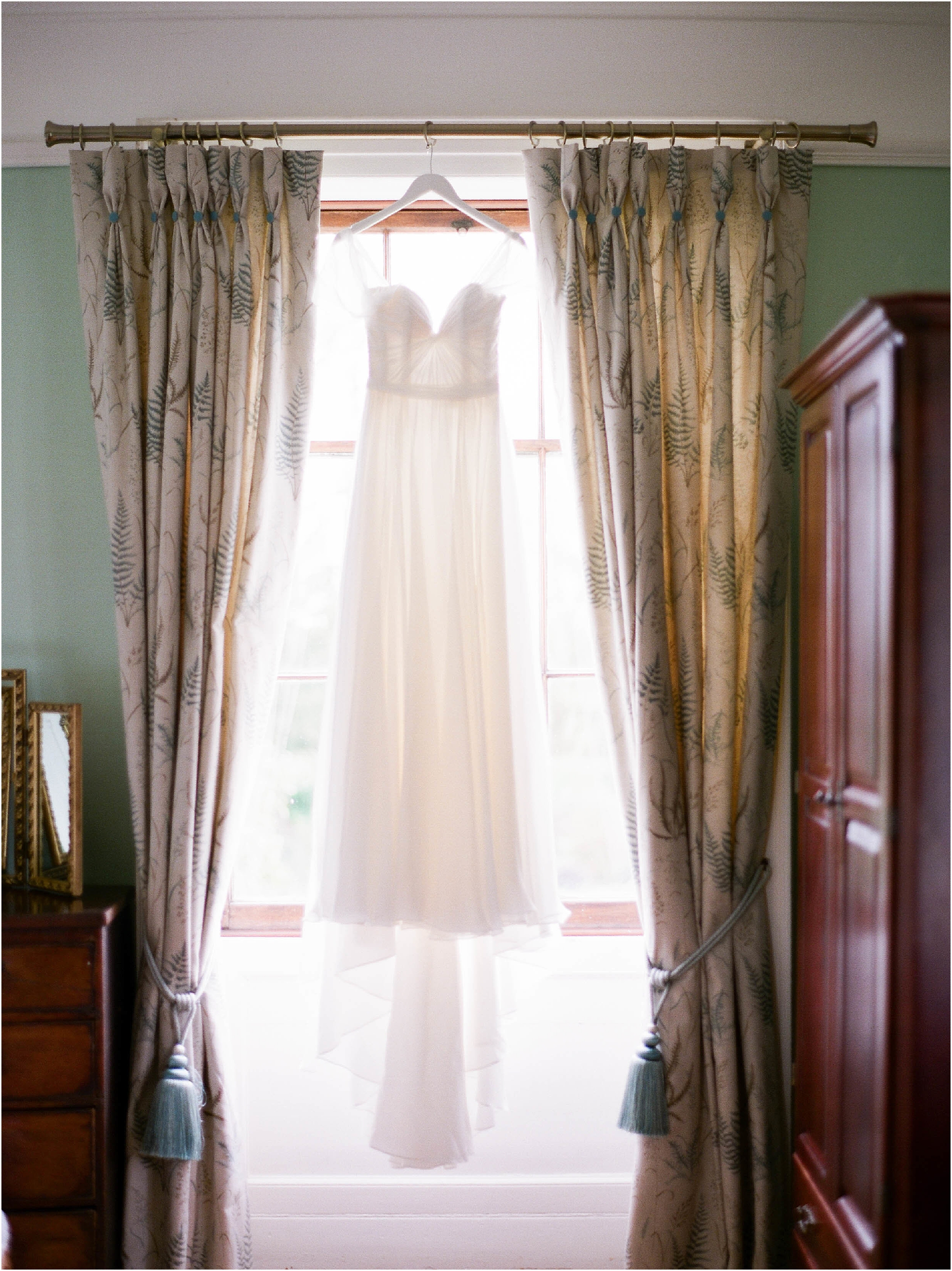 Naomi Neoh wedding dress hanging in window