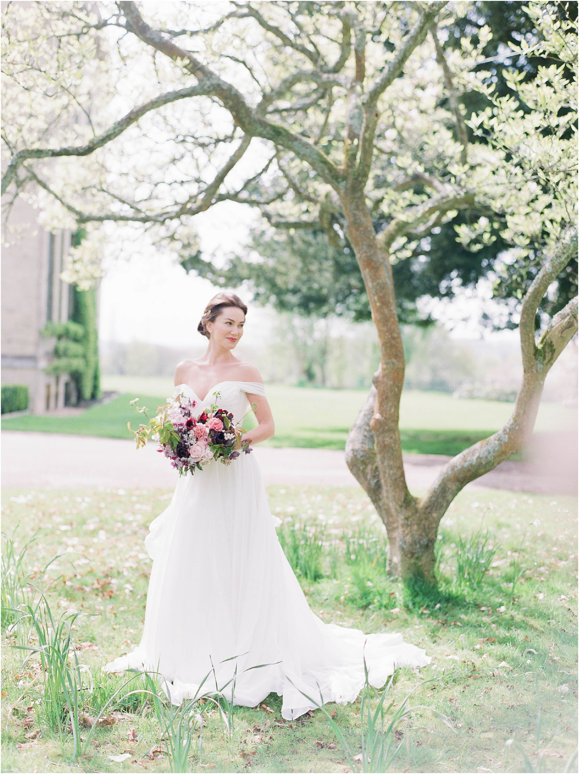 Bride standing under magnolia tree at Hill Place