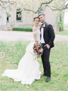 Bride and groom standing outside Hill Place Wedding Venue Hampshire
