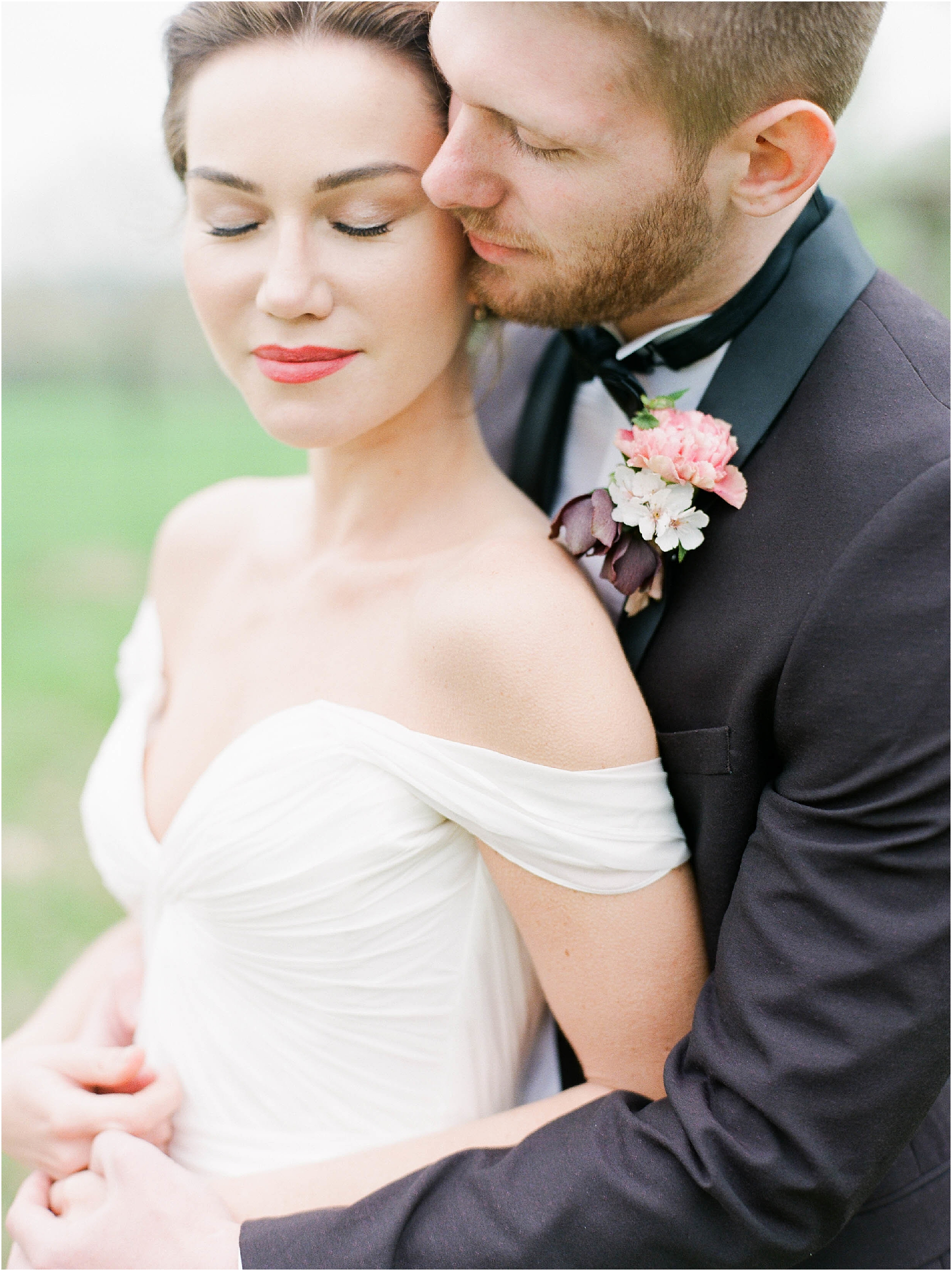 Bride and Groom in tender embrace by film wedding photographer Camilla Arnhold