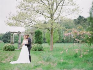 Bride and groom cuddling at their Hill Place elopement wedding