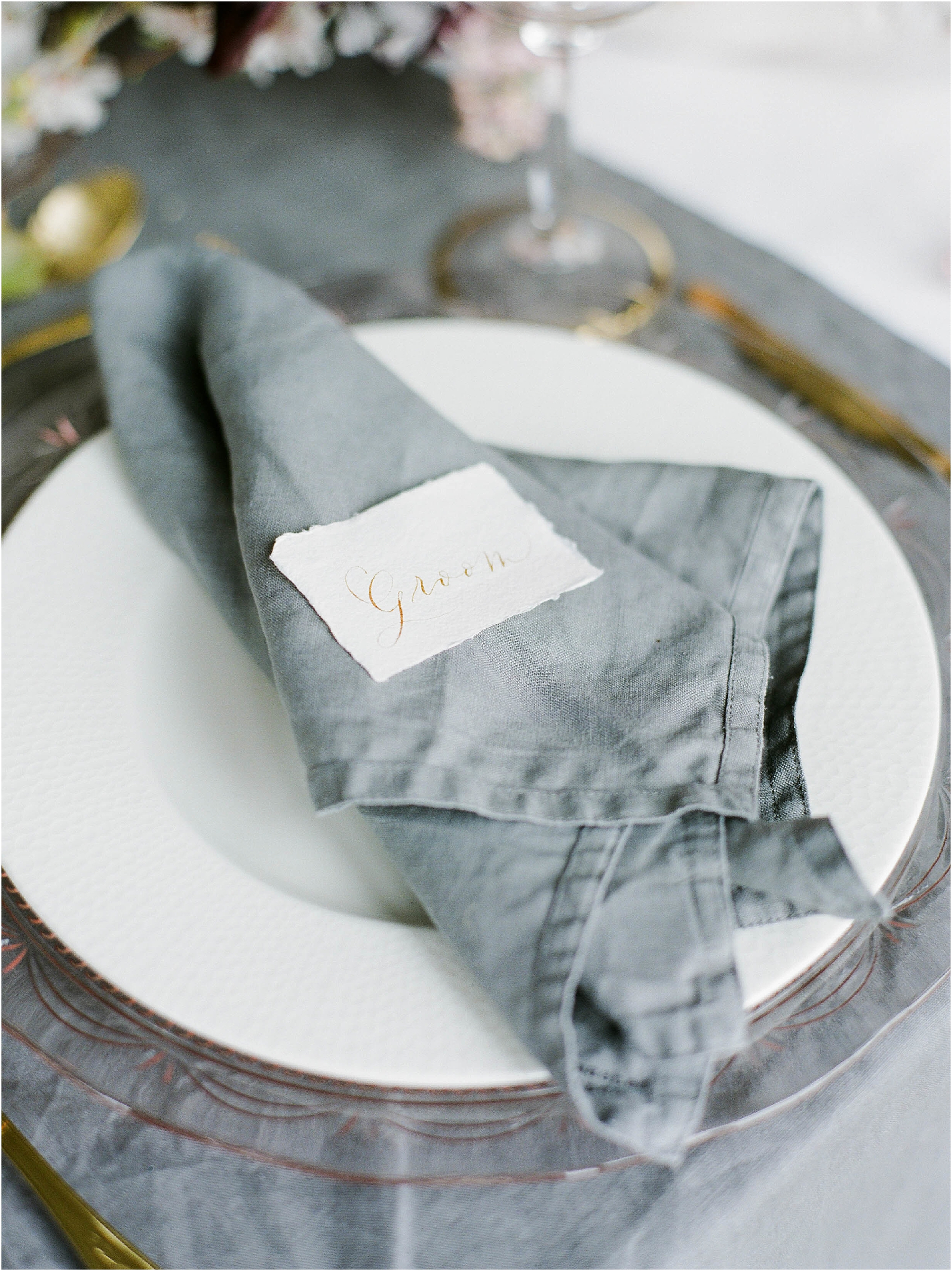 Groom table place name on grey linen napkin